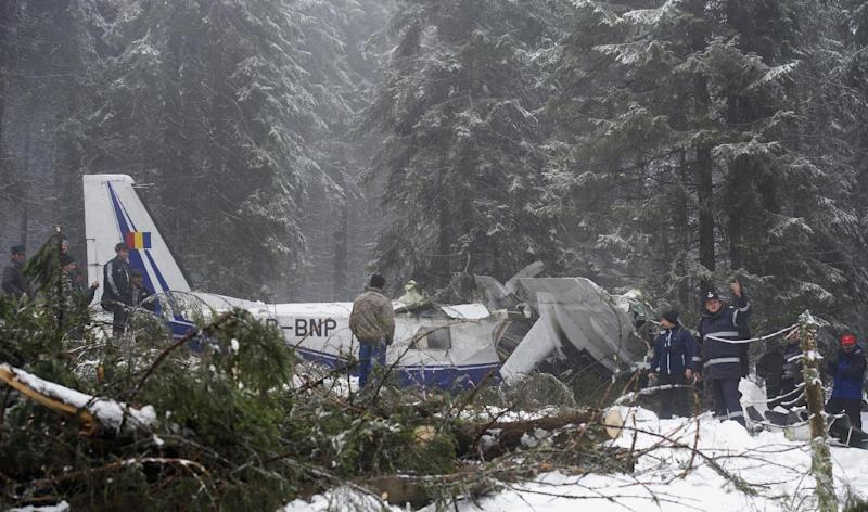 In this Wednesday, Jan. 22, 2014 photo, the wreckage of a small plane is seen near the Petreasa peak in western Romania. The small plane, carrying a pilot and six medical workers to harvest organs for transplant, crashed on a mountain Monday, Jan. 20, 2014. Residents located the plane four and a half hours after it crashed, but medical teams arrived much later, provoking public anger. The pilot and a medical student died from hypothermia and multiple injuries.(AP Photo/Catalin Cadan/Mediafax Foto) ROMANIA OUT