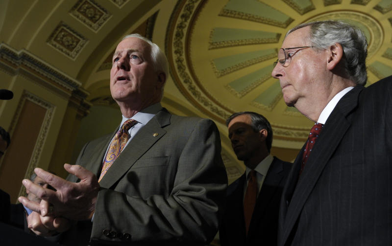 Senate Minority Leader Mitch McConnell of Kentucky, listens at right as Senate Minority Whip John Cornyn of Texas, left, speaks to reporters on Capitol Hill in Washington, Tuesday, Oct. 1, 2013, following a policy luncheon. Lawmakers on Capitol Hill continue to scramble to reach agreement on funding the federal government. (AP Photo/Susan Walsh)