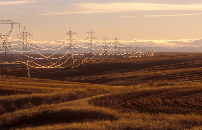 Utility power lines span a rural scene.