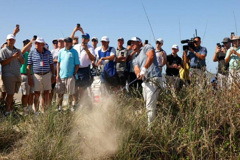 American Brooks Koepka hits out of the sand in the first round of the 2021 PGA Championship at Kiawah Island Resort's Ocean Course