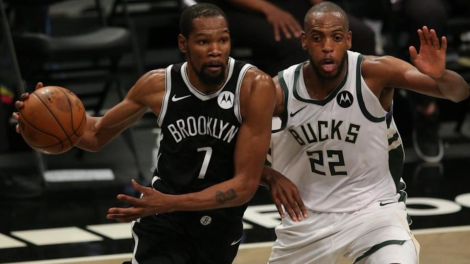 Kevin Durant drives past Bucks Game 1
