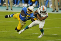 Los Angeles Chargers defensive tackle Justin Jones (93) attempts to tackle Miami Dolphins running back Malcolm Perry (10) during the first half of an NFL football game, Sunday, Nov. 15, 2020, in Miami Gardens, Fla. (AP Photo/Wilfredo Lee)