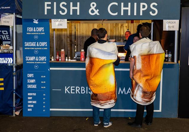 Nothing to see here, folks. Just some beers buying some fish and chips. (Photo by Peter Dench/Getty Images)