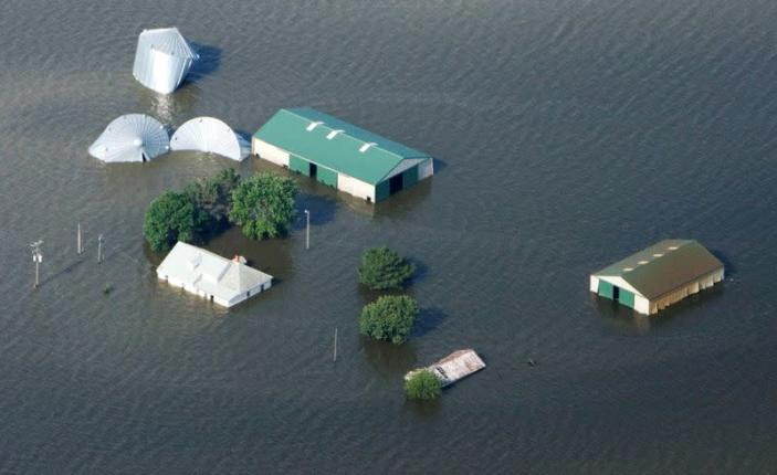 FILE PHOTO: An aerial view of a farm north of Council Bluffs, Iowa, submerged in Missouri River flood waters