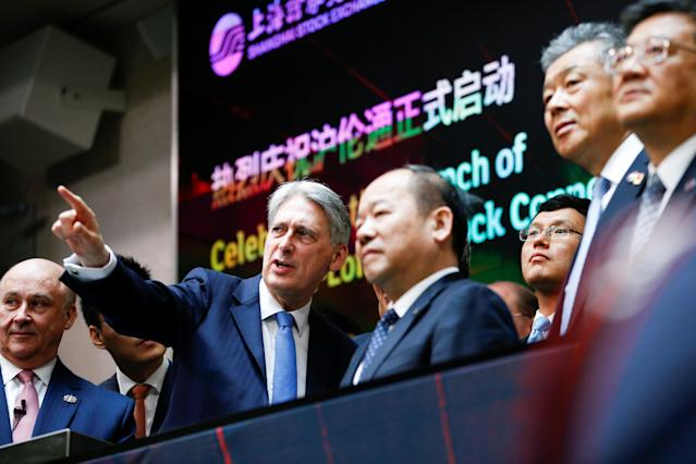 Former UK chancellor Philip Hammond, second from left, and Chinese vice-premier Hu Chunhua attend the opening of the markets at the London Stock Exchange on 17 June 2019. Photo: Henry Nicholls/WPA Pool/Getty Images