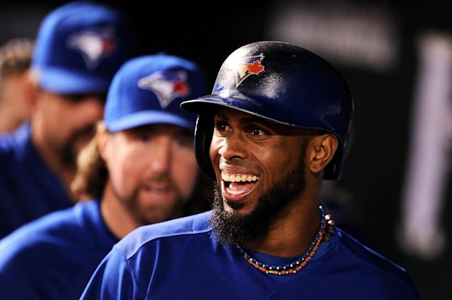 BALTIMORE, MD - SEPTEMBER 24: Jose Reyes #7 of the Toronto Blue Jays smiles in the dugout after scoring off of a Mark DeRosa hit against the Baltimore Orioles in the 10th inning at Oriole Park at Camden Yards on September 24, 2013 in Baltimore, Maryland. (Photo by Patrick Smith/Getty Images)