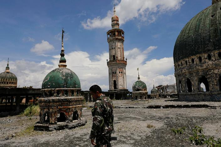 A soldier walks on the rooftop of the war-torn Grand Mosque in Marawi City, Lanao del Sur province, Philippines. (Photo: Eloisa Lopez/Reuters)