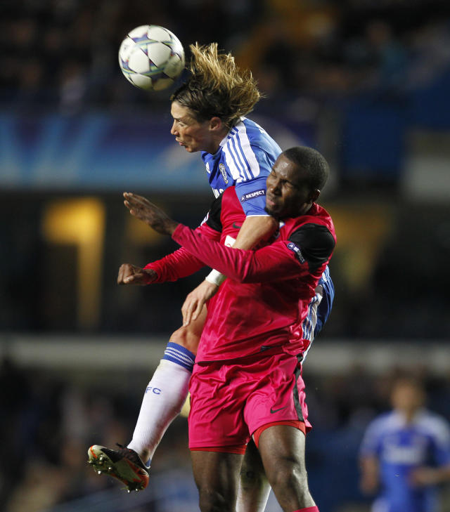 Chelsea's Spanish Fernando Torres (L) vies with Genk's Khaleem Hyland during a UEFA Champions League Group E football match between Chelsea and KRC Genk at Stamford Bridge in London on October 19, 2011. AFP PHOTO / IAN KINGTON (Photo credit should read IAN KINGTON/AFP/Getty Images)