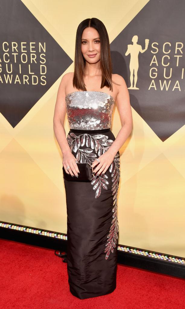 <p>Munn was all about the metallics in her dress, which featured a sequined top. (Photo: Getty Images) </p>
