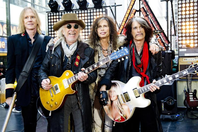 """FILE - This Nov. 2, 2012 file photo shows, from left, Tom Hamilton, Brad Whitford, Steven Tyler and Joe Perry of Aerosmith perform on NBC's """"Today"""" show in New York. Aerosmith, James Taylor, and Jimmy Buffett are among the scheduled performers for a Boston Marathon benefit concert May 30. The show, at the TD Garden, will benefit One Fund _ the collection of donations that will be distributed to the survivors of the April 15 bombings and the families of those killed in the attack. (Photo by Charles Sykes/Invision/AP, file)"""