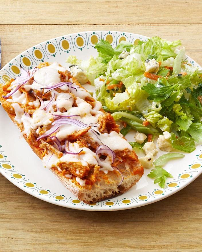 """<p>These personal-sized Buffalo chicken pizzas are a kid-friendly meal that you'll enjoy as well!</p><p><strong><a href=""""https://www.thepioneerwoman.com/food-cooking/recipes/a32601937/buffalo-chicken-french-bread-pizzas-recipe/"""" rel=""""nofollow noopener"""" target=""""_blank"""" data-ylk=""""slk:Get the recipe."""" class=""""link rapid-noclick-resp"""">Get the recipe.</a></strong> </p>"""