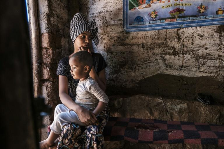 A refugee and her child, pictured at the Mai Aini camp for Eritrean refugees in Ethiopia in January. Thousands of refugees have flooded into the overcrowded facility since two other camps were destroyed, the UN says