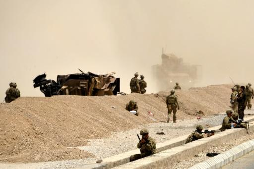 US soldiers and their wrecked vehicle after a Taliban suicide attack in Kandahar in August 2017