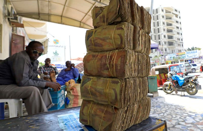 FILE PHOTO: Bundles of Somalian currency are seen arranged at an open air currency exchange bureau within the Hamarweyne open air market in Mogadishu