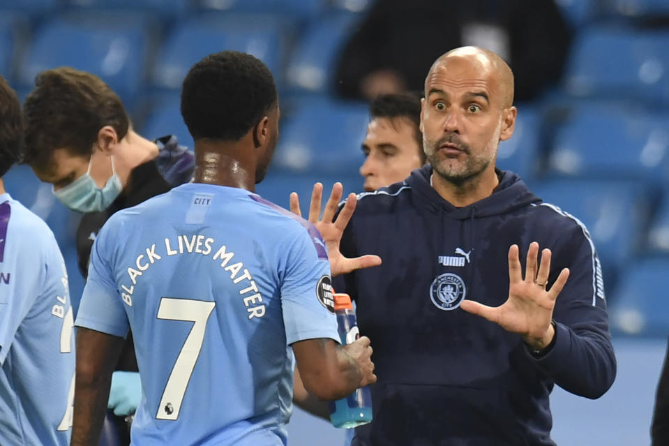 Pep Guardiola (right), Raheem Sterling and Manchester City beat Arsenal in a game befitting this strange season. (Photo by PETER POWELL/POOL/AFP via Getty Images)