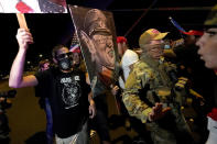 Counter-protesters, left, engage with supporters of President Donald Trump, right, outside the Maricopa County Recorder's Office, Thursday, Nov. 5, 2020, in Phoenix. (AP Photo/Matt York)