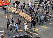 Protesters march to demonstrate against the death in Minneapolis police custody of George Floyd, on Flatbush Avenue in Brooklyn toward the Manhattan Bridge, New York