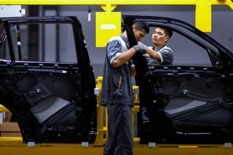 The pandemic has not only hit Vietnam's textile industry but is also threatening car companies (AFP/Manan VATSYAYANA)