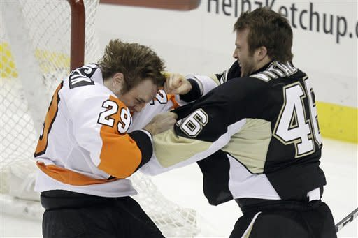 Philadelphia Flyers' Harry Zolnierczyk (29) fights with Pittsburgh Penguins Joe Vitale (46) during the first period of an NHL hockey game against the Pittsburgh Penguins in Pittsburgh Saturday, April 7, 2012. (AP Photo/Gene J. Puskar)