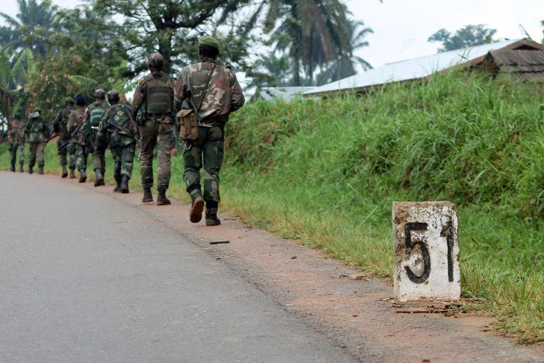 File photo taken on December 31, 2013 shows Democratic Republic of Congo (FARDC) soldiers marching towards the front line in Beni, eastern DR Congo to fight against rebels opposed to the Ugandan government