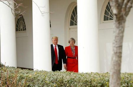 U.S. President Trump escorts British Prime Minister May after their meeting at the White House in Washington