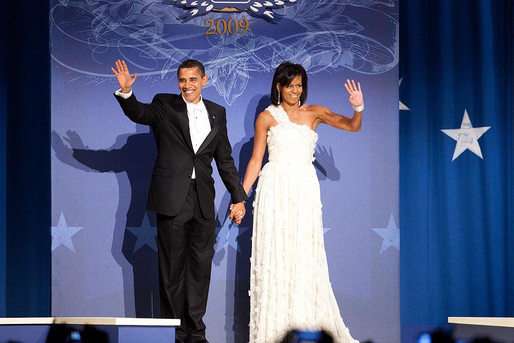 """All eyes were on President Barack Obama and his wife Michelle as they took the stage at the Southern Inaugural Ball -- one of ten inaugural balls they attended Tuesday evening. Continuing her trend of wearing dresses by up-and-comers, the First Lady chose an ivory, crystal-studded gown by Taiwanese-American designer Jason Wu. Brendan Hoffman/<a href=""""http://www.gettyimages.com/"""" target=""""new"""">GettyImages.com</a> - January 21, 2009"""
