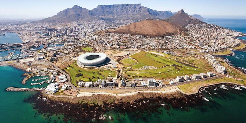 """<p>Often called South Africa's prettiest city, <a href=""""https://www.tripadvisor.com/Tourism-g1722390-Cape_Town_Western_Cape-Vacations.html#"""" rel=""""nofollow noopener"""" target=""""_blank"""" data-ylk=""""slk:Cape Town"""" class=""""link rapid-noclick-resp"""">Cape Town</a> is located on the country's southwestern coast and sits in the shadow of iconic Table Mountain.</p><p>While there, you can visit <a href=""""https://www.tripadvisor.com/Attraction_Review-g312659-d311008-Reviews-Robben_Island_Museum-Cape_Town_Central_Western_Cape.html"""" rel=""""nofollow noopener"""" target=""""_blank"""" data-ylk=""""slk:Robben Island"""" class=""""link rapid-noclick-resp"""">Robben Island</a>, the prison where Nelson Mandela was held, and within a few hours' drive is the scenic <a href=""""https://www.bestproducts.com/fun-things-to-do/g19840724/wine-regions-around-the-world/"""" rel=""""nofollow noopener"""" target=""""_blank"""" data-ylk=""""slk:Stellenbosch"""" class=""""link rapid-noclick-resp"""">Stellenbosch</a> wine region, with award-winning scenic wineries and upscale hotels overlooking vineyards.</p>"""