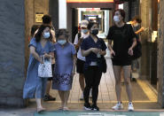 People wear face masks to protect against the spread of the coronavirus in Taipei, Taiwan, Sunday, Aug. 29, 2021. (AP Photo/Chiang Ying-ying)