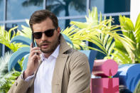 "This image released by Lionsgate shows Jamie Dornan in ""Barb and Star Go to Vista Del Mar."" (Cate Cameron/Lionsgate via AP)"