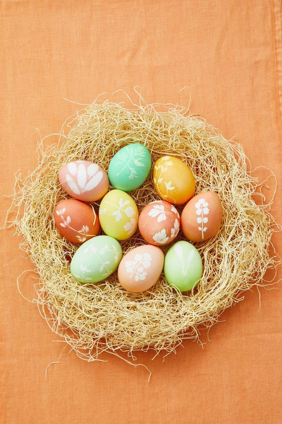 """<p>Natural herbs like thyme and sage make the most beautiful patterns for your Easter eggs. Once you're finished decorating, toss the eggs in a fake nest for an unforgettable display.</p><p><strong><em><a href=""""https://www.womansday.com/home/crafts-projects/g2216/easter-eggs/?slide=10"""" rel=""""nofollow noopener"""" target=""""_blank"""" data-ylk=""""slk:Get the Dipped Herb Silhouettes tutorial."""" class=""""link rapid-noclick-resp"""">Get the Dipped Herb Silhouettes tutorial.</a></em></strong></p><p><strong><a class=""""link rapid-noclick-resp"""" href=""""https://www.amazon.com/Round-Artificial-Moss-Nest-Ornament/dp/B00IMN9MGU/?tag=syn-yahoo-20&ascsubtag=%5Bartid%7C10070.g.1751%5Bsrc%7Cyahoo-us"""" rel=""""nofollow noopener"""" target=""""_blank"""" data-ylk=""""slk:SHOP ARTIFICIAL MOSS NESTS"""">SHOP ARTIFICIAL MOSS NESTS</a></strong></p>"""