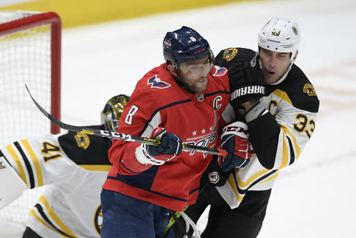 FILE - Washington Capitals left wing Alex Ovechkin (8), of Russia, and Boston Bruins defenseman Zdeno Chara (33), of Slovakia, battle for position during the third period of an NHL hockey game in Washington, in this, Wednesday, Dec. 11, 2019, file photo. The Capitals won 3-2. Ovechkin goes into the final year of his contract with the Capitals looking to win the Stanley Cup for the second time. Hell have 43-year-old past champion Zdeno Chara with him but not Henrik Lundqvist chasing his first title, after tests showed the veteran goaltender couldnt keep playing because of a heart condition. (AP Photo/Nick Wass, File)