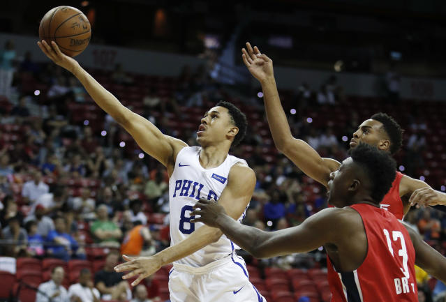 "<a class=""link rapid-noclick-resp"" href=""/nba/players/6027/"" data-ylk=""slk:Zhaire Smith"">Zhaire Smith</a> goes to the basket during summer league in Las Vegas. (AP)"