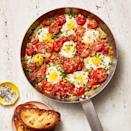 """<p>Just wait 'til you break this one out at the breakfast table: sweet tomatoes, runny yolks, and plenty of toasted bread for dipping.</p><p><em><a href=""""https://www.goodhousekeeping.com/food-recipes/a34908201/easy-shakshuka-recipe/"""" rel=""""nofollow noopener"""" target=""""_blank"""" data-ylk=""""slk:Get the recipe for Shakshuka »"""" class=""""link rapid-noclick-resp"""">Get the recipe for Shakshuka »</a></em></p>"""