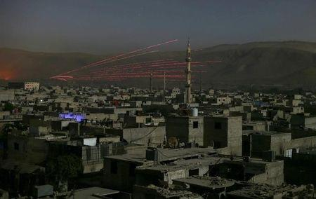 A fire trail is seen during clashes between forces loyal to Syria's President Bashar al-Assad and the Army of Islam fighters, on the eastern mountains of Qalamoun overlooking the town of Douma, eastern Ghouta, near Damascus, Syria October 1, 2015. REUTERS/Bassam Khabieh