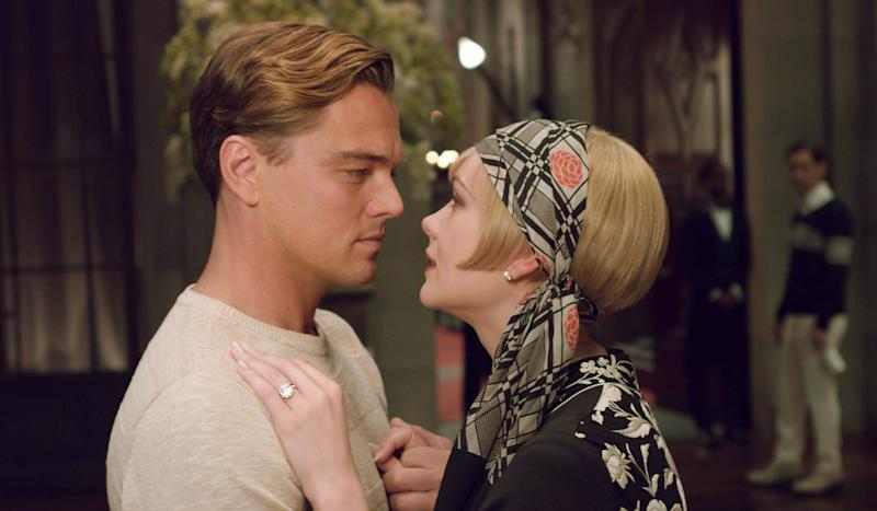 """This film publicity image released by Warner Bros. Pictures shows Carey Mulligan as Daisy Buchanan, right, and Leonardo DiCaprio as Jay Gatsby in a scene from """"The Great Gatsby."""" Baz Luhrmann's big screen adaption of """"The Great Gatsby"""" is shining a spotlight on Roaring Twenties glam fashions, from drop-waist dresses and head scarves to crisp bow ties and spectator shoes. (AP Photo/Warner Bros. Pictures)"""