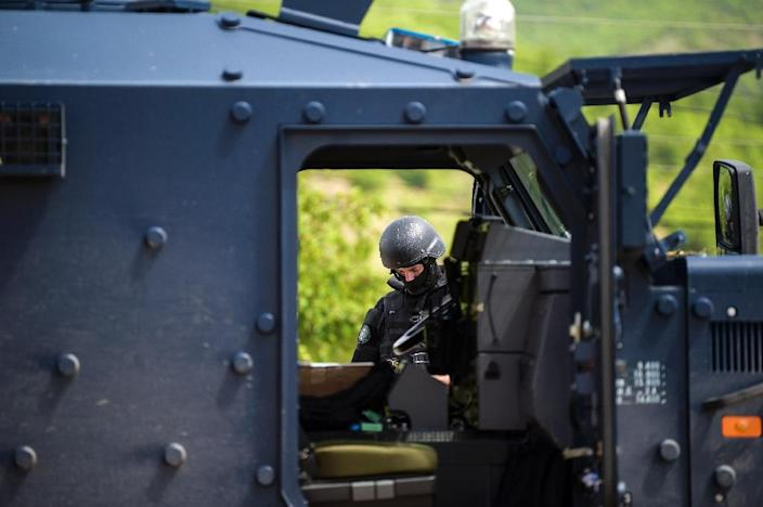 Members of the Kosovo Police Special Unit arrested local officers among the suspects (AFP Photo/Armend NIMANI)