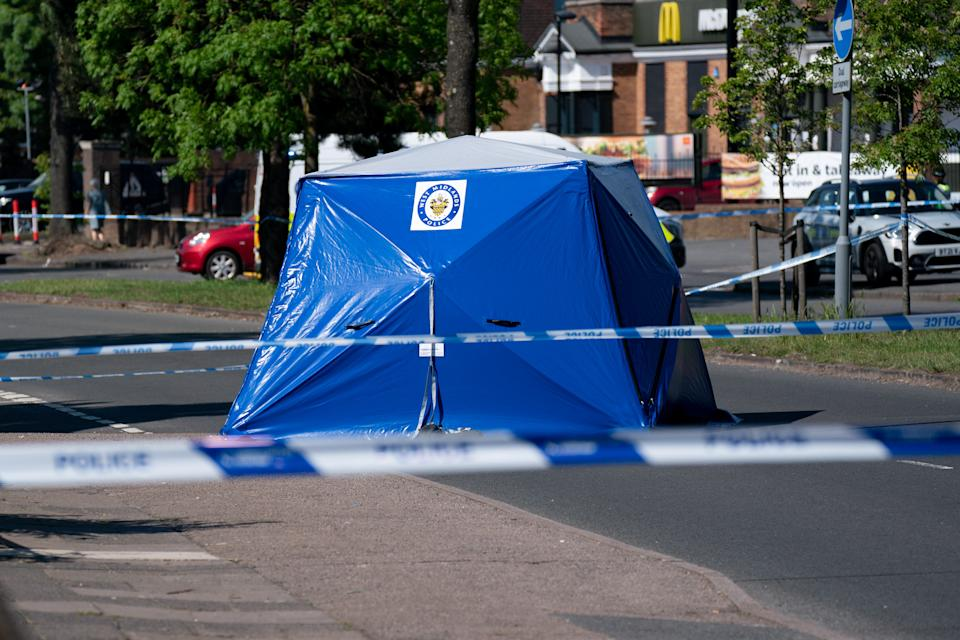 A police tent at the scene on College Road, Kingstanding, north of Birmingham, where a 14-year-old boy died after being stabbed on Monday evening. Police have launched a murder investigation and are hunting up to seven people in connection with the attack. Picture date: Tuesday June 1, 2021.