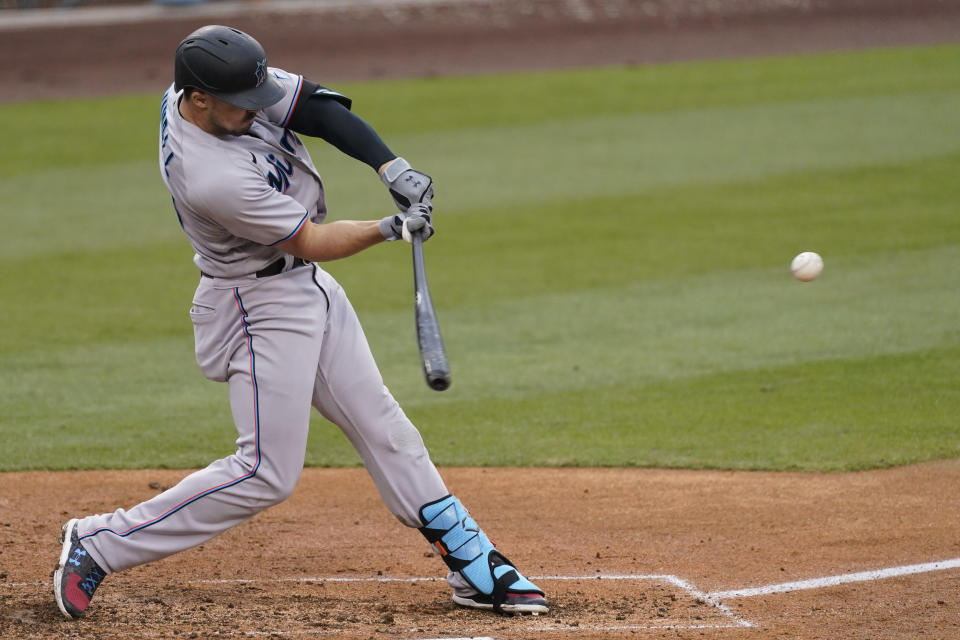 CORRECTS TO PABLO LOPEZ NOT PANLO LOPEZ - Miami Marlins' Adam Duvall (14) hits a home run during the fifth inning of a baseball game against the Los Angeles Dodgers, Sunday, May 16, 2021, in Los Angeles. Pablo Lopez and and Jazz Chisholm Jr. also scored. (AP Photo/Ashley Landis)