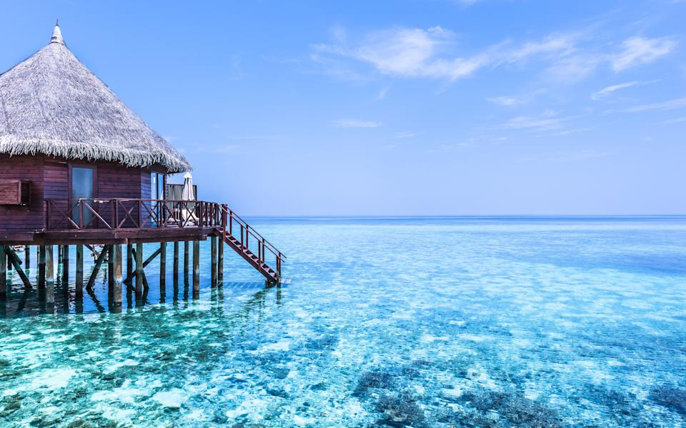 Part of the water bungalow. Stairs down to the ocean. Rest on the sea. The output of absolute relaxation. Maldives. Tropical island resort. (Photo: Maryna Patzen via Getty Images)