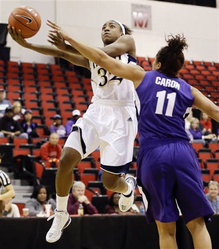 Notre Dame's Jewell Loyd, left, shoots against Kansas State's Natalie Achonwa (11) during the first half of an NCAA college basketball game, Thursday, Dec. 20, 2012, in Las Vegas. (AP Photo/Julie Jacobson)