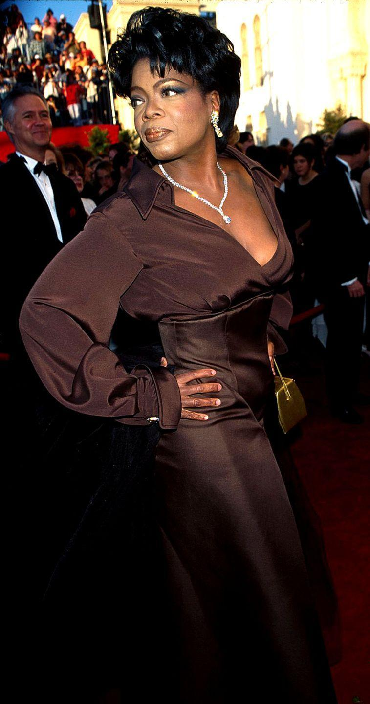 <p>Oprah sported this monochrome ensemble and ogle-worthy diamonds the same year she was named the richest woman in entertainment. Honestly, goals.</p>