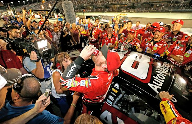 <p>Dale Earnhardt Jr., driver of the #88 AXALTA Chevrolet, celebrates with teammates after his final cup series race, the Monster Energy NASCAR Cup Series Championship Ford EcoBoost 400 at Homestead-Miami Speedway on November 19, 2017 in Homestead, Florida. (Photo by Jonathan Ferrey/Getty Images) </p>