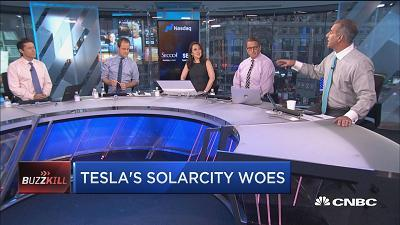 "The ""Fast Money"" traders discuss Tesla stock, which was down on Solarcity's settlement with the Department of Justice."
