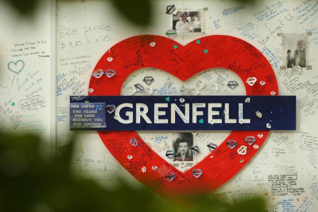 Messages of support on a wall surrounding Grenfell Tower in west London (Picture: AFP/Getty)