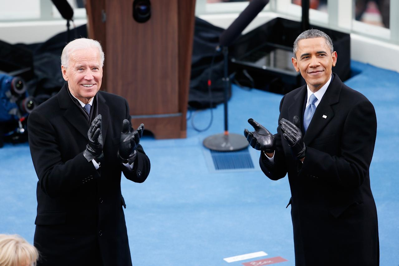 U.S. President Barack Obama (R) and U.S. Vice President Joe Biden clap during the presidential inauguration on the West Front of the U.S. Capitol January 21, 2013 in Washington, DC.   Barack Obama was re-elected for a second term as President of the United States.  (Photo by Rob Carr/Getty Images)