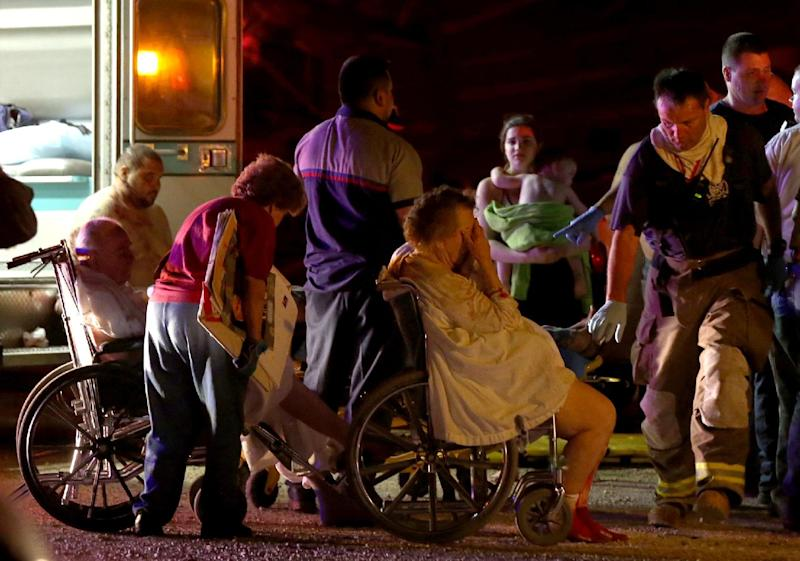Emergency workers evacuate elderly from a damaged nursing home following an explosion at a fertilizer plant Wednesday, April 17, 2013, in West, Texas. An explosion at a fertilizer plant near Waco caused numerous injuries and sent flames shooting high into the night sky on Wednesday. (AP Photo/ Waco Tribune Herald, Rod Aydelotte)