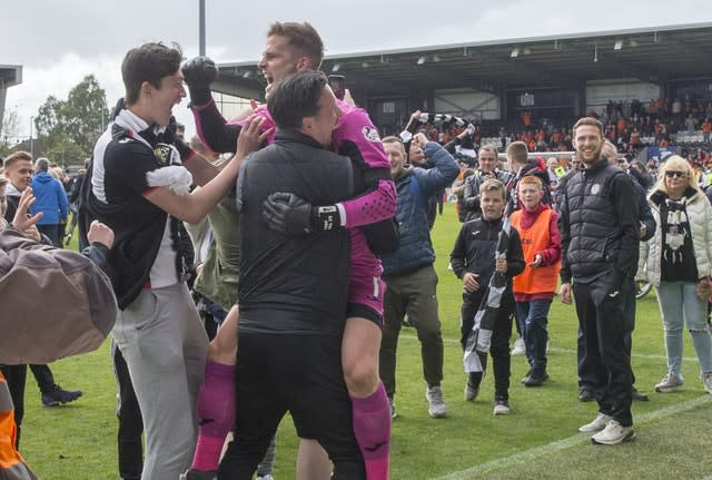 Vaclav Hladky celebrates with St Mirren fans after the Premiership play-off final second leg