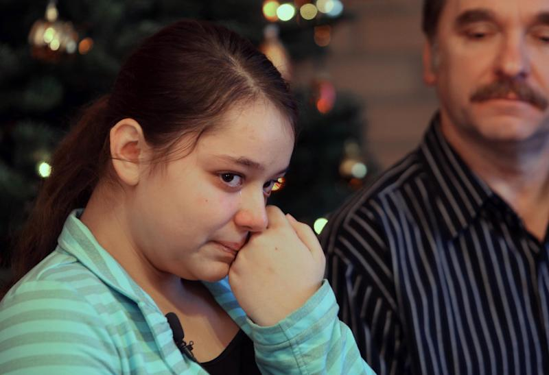 Kristina Shevchenko, Clackamas Town Center shooting victim, talks to reporters for first time at her house as her father Veniamin looks on, Saturday, Dec. 22, 2012 in Portland, Ore. Kristina Shevchenko, a 15-year-old girl was seriously wounded when a gunman killed two people and then himself at an Oregon shopping mall. (AP Photo/The Oregonian, Motoya Nakamura) MAGS OUT; TV OUT; LOCAL TV OUT; LOCAL INTERNET OUT; THE MERCURY OUT; WILLAMETTE WEEK OUT; PAMPLIN MEDIA GROUP OUT