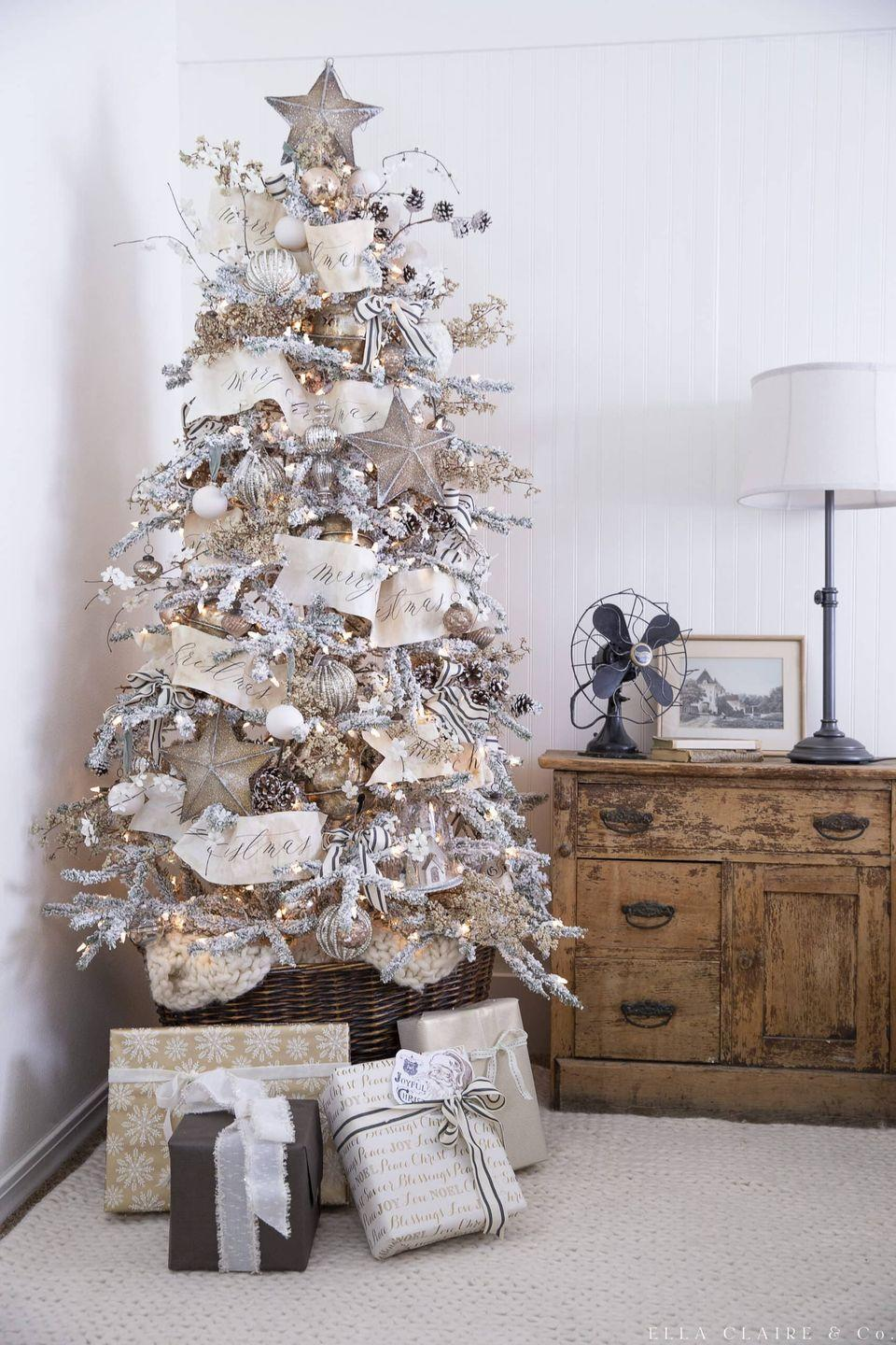 """<p>If you're going for an elegant Christmas tree this year, look no further. This gold tree with white, cream, and other metallic neutrals will make any room in the house shine. </p><p><strong><em>Get the tutorial at <a href=""""https://www.ellaclaireinspired.com/gold-christmas-tree/"""" rel=""""nofollow noopener"""" target=""""_blank"""" data-ylk=""""slk:Ella Claire & Co"""" class=""""link rapid-noclick-resp"""">Ella Claire & Co</a>.</em></strong></p><p><a class=""""link rapid-noclick-resp"""" href=""""https://www.amazon.com/Boao-Valentines-Ornament-Five-Pointed-Decoration/dp/B07YDR3JM1?tag=syn-yahoo-20&ascsubtag=%5Bartid%7C10070.g.2025%5Bsrc%7Cyahoo-us"""" rel=""""nofollow noopener"""" target=""""_blank"""" data-ylk=""""slk:BUY GOLD STAR ORNAMENTS"""">BUY GOLD STAR ORNAMENTS</a></p>"""