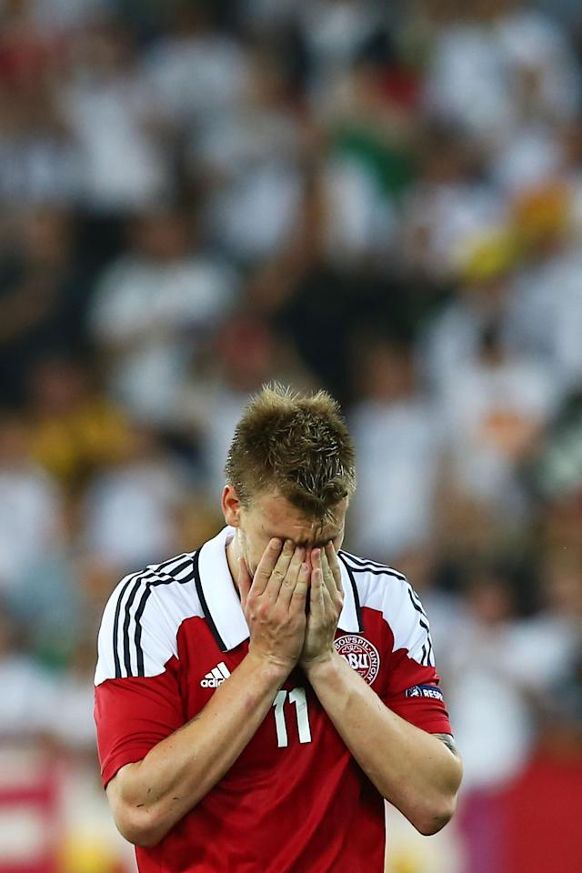 L'VIV, UKRAINE - JUNE 17: Nicklas Bendtner of Denmark puts his head in his hands after the UEFA EURO 2012 group B match between Denmark and Germany at Arena Lviv on June 17, 2012 in L'viv, Ukraine. (Photo by Martin Rose/Getty Images)